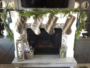 Fresh Garland, fur stockings, mercury ornaments, and twine. What's not to love?