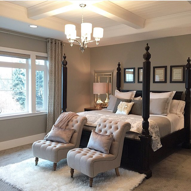 Neutral bedroom with Black four poster bed