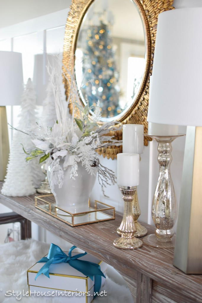 Strategically placing mirrors at in your christmas decor to reflect your christmas tree adds the illusion of more Christmas lights