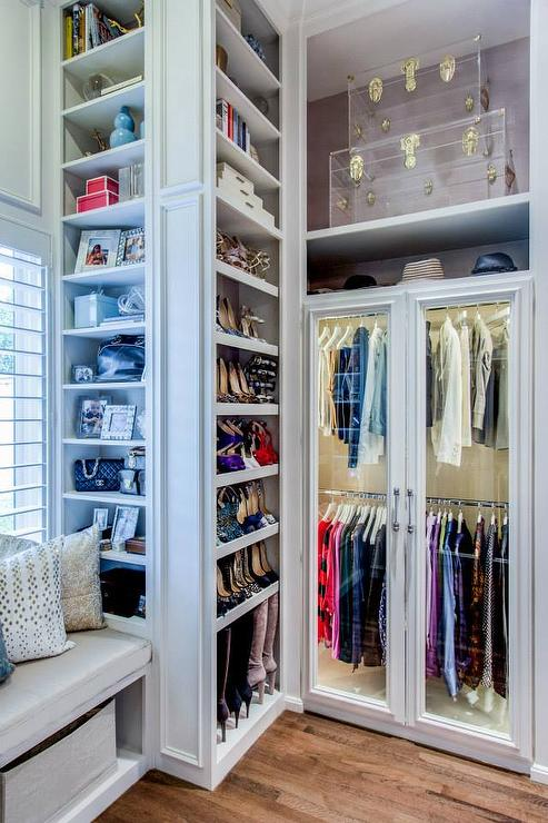 The Details In This Closet Are What Make E Trim Work Built Window Seat And Don T Forget Lighted Wardrobe With Gl Front Doors