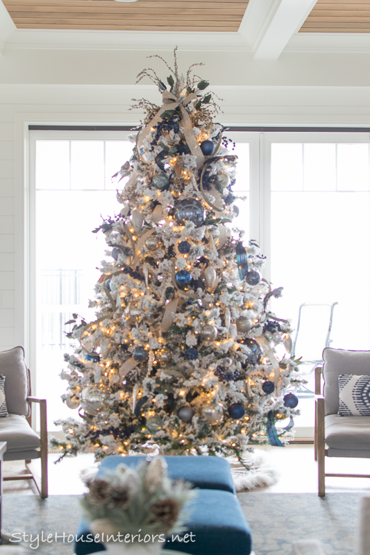 I always use at least two types of ribbon on my trees, on this tree I used a blue and green plaid and a tan ribbon with silver glittery dots. The ornaments ...