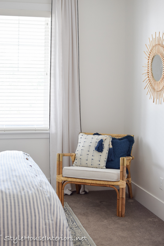Rattan chair blue and white bedroom